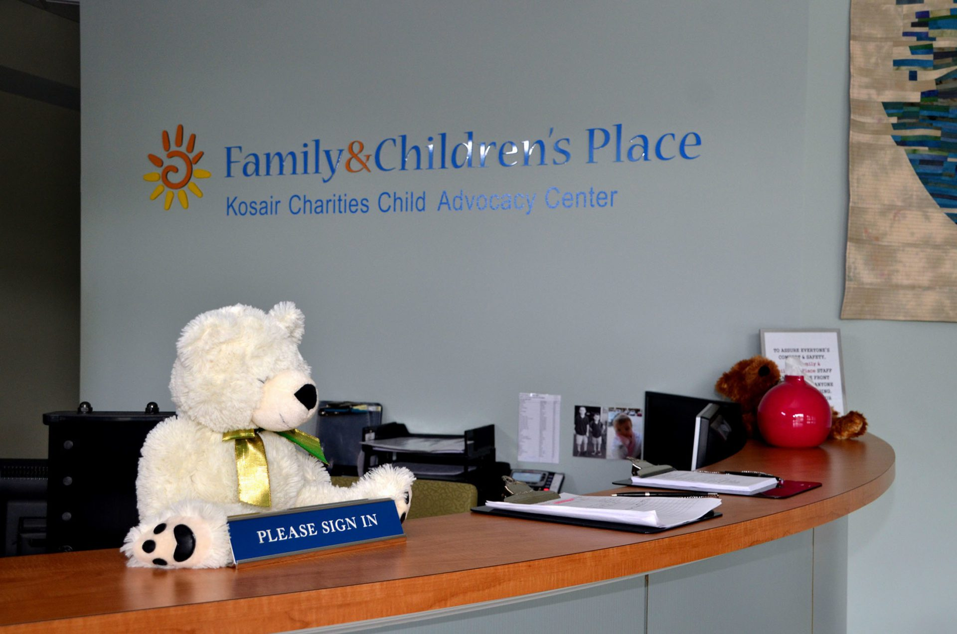Family & Childrens Place front desk with bear